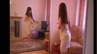 amputee girl doing sports in the room