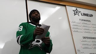Dez Bryant announces the Stars' starting lineup in the locker room