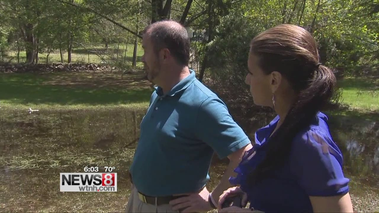 Backyard flooding causing problems youtube for Yard flooding problems