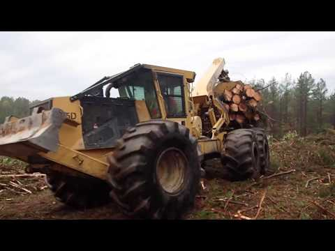A loaded Peterbilt log truck in the ditch & our Tigercat 635D