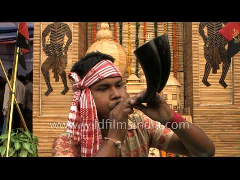 Indian boy plays 'Pepa', a traditional musical instrument fr