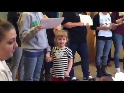 Astra receiving Drake Award from Ms. Katie, Scott Dual Language Magnet Pre-K