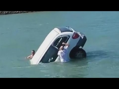 Watch Swimmers Try to Save Father, Daughter Trapped Inside Sinking SUV