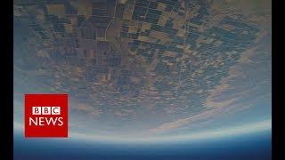 Wingsuit pilot 'faster than a supercar'   BBC News
