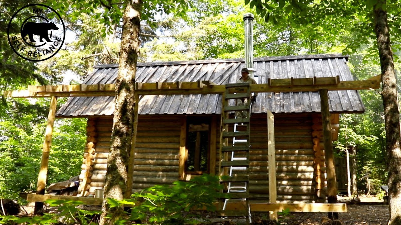 My Self Reliance Changing  the Roof On My Log Cabin
