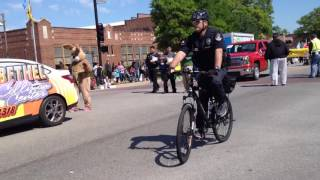 2 Broken Arrow Police bicycle officers passing by