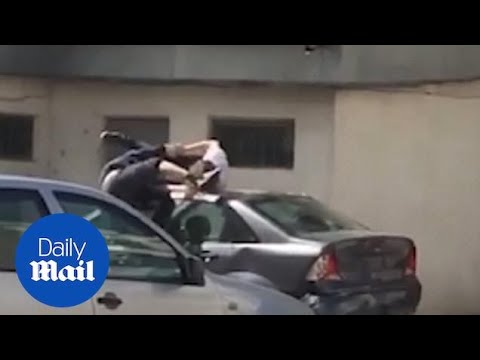 Hilarious moment drunk friends tumble off a garage roof