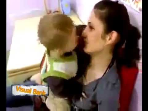Kiss competition between a baby & his mom- cute baby struggling to kiss