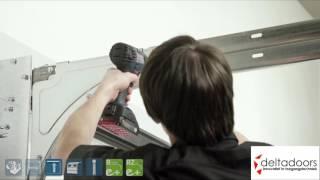 Montagevideo van de garagedeur met torsieveren