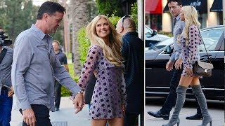Christina El Moussa beams as she steps out with new boyfriend Doug in flirty purple frock