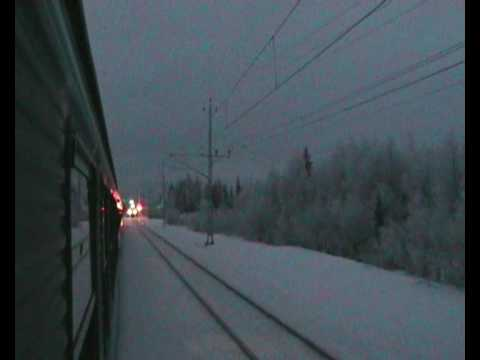 Iron ore train under a frosty electric wire