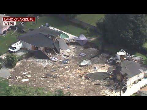 Sinkhole swallows homes in Florida neighborhood