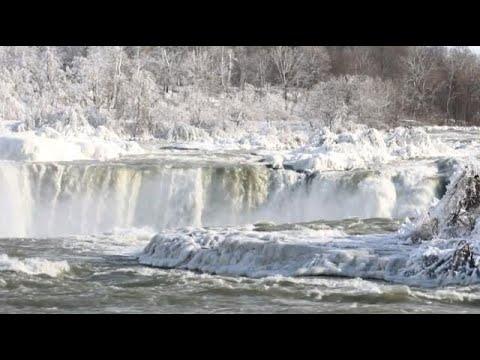 Niagara Falls partially frozen over in North American cold snap