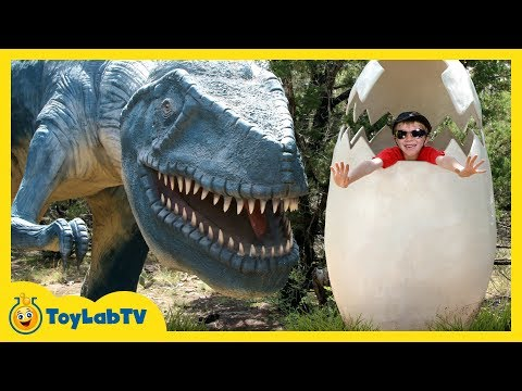GIANT LIFE SIZE DINOSAURS IRL! Dinosaur World Park, Family Fun Activities, Kids Toys & Surprise Eggs