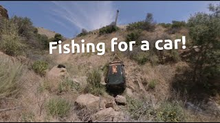 Fishing a brand new car off a cliff
