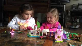 Girls playing disney legos and using their imagination