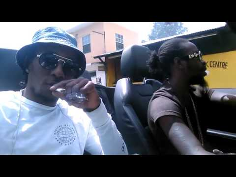 Popcaan Listening To Aidonia Songs In His New Convertable Range Rover