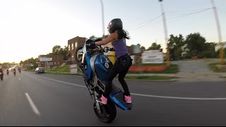 Crazy girl does motorcycle stunts on St. Louis streets 2015 Video
