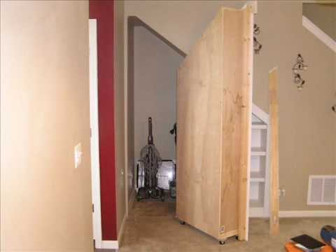 Hidden Storage Behind Moving Bookcase Youtube