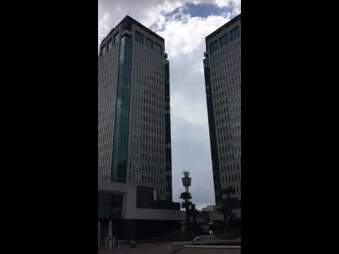 Clouds Walking On Building Panning Time-lapse