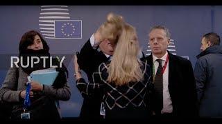 Belgium Juncker flips woman s hair as leaders arrive for EC summit in Brussels