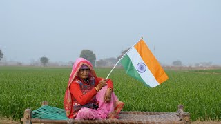 An old village woman holding the Indian national flag on Independence/Republic Day