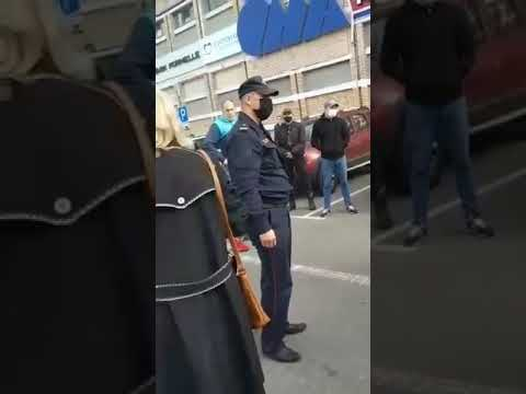 Download In Minsk, Belarus, a policeman hit a woman in the face and she fell.