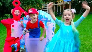 Pretend play Princess in Frozen Dress with Mario build a house Castle for children