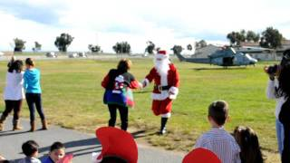 Santa arriving to Stuart Mesa Elementary in helicopter 12/2011