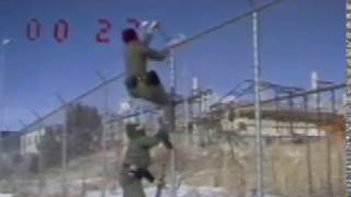 B-Roll footage showing actors scaling a fence