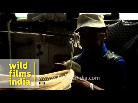 Man winds wool: Inside Tibetan Refugee Camp, Darjeeling