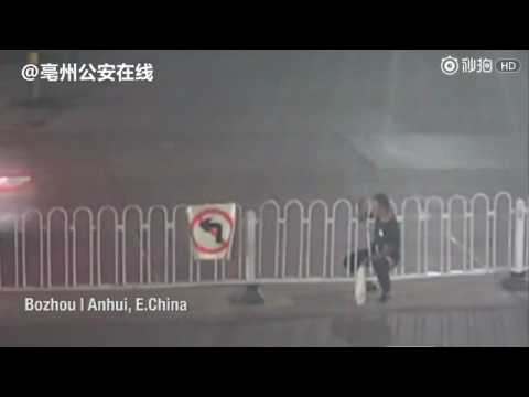 Jaywalker got stuck on fence in Bozhou, east China's Anhui province