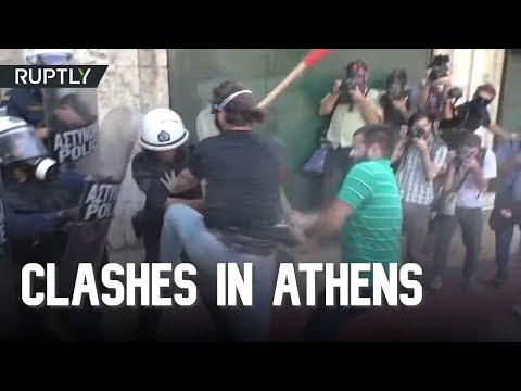 Police tear gas students protesting business reforms in Athens