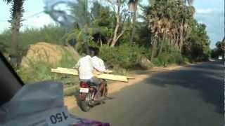 Carrying long objects on motorcycle