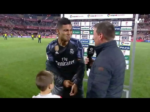 Young child interrupts casemiro interview to ask shirt from him.