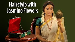Hair adornment with jasmine garland Lifestyle Kerala