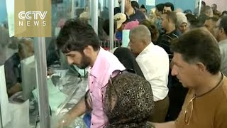 thousands of iraqis race to get passports to europe