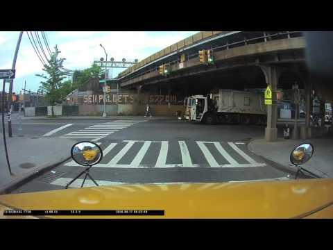 NEW YORK CITY SANITATION RUNNING THE RED LIGHT