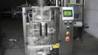 Volumetric cup filler and vertical packaging machine