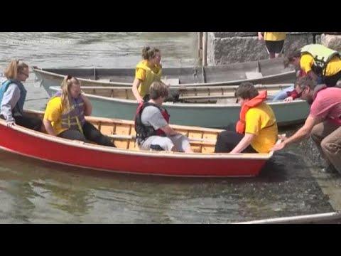 Brooklin school kids proudly launch boat
