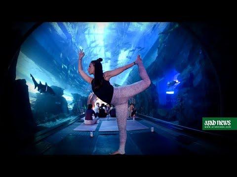Yoga class convenes inside Dubai Mall aquarium