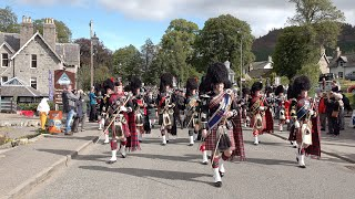 Massed Pipes and Drums march to the 2019 Braemar Gathering in Royal Deeside, Aberdeenshire, Scotland
