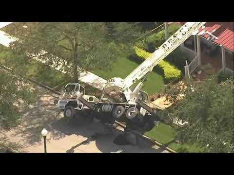 Crane falls onto Orlando home, slicing roof