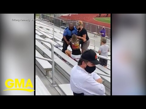 Officer tases, arrests woman for not wearing a mask at football game l GMA