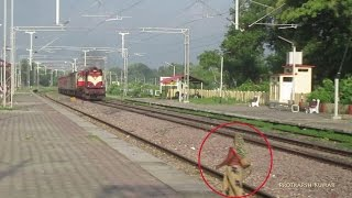 Crazy Woman trying to cross tracks infront of speeding train- 11015 Kushinagar Express