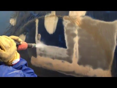 Graco EcoQuip -Vapour Blasting a train  - supplied by Fluid Technologies Ltd