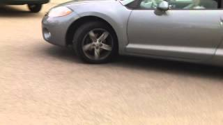 a manual mitsubishi eclipse car starting up and driving off from my neighbour hood in edmonton