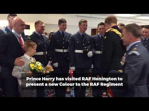 Prince Harry has fun meeting children at RAF Honington
