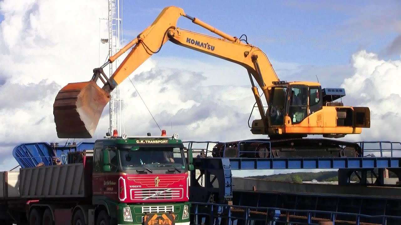 Ship Mounted Komatsu Excavator Loading Volvo And Scania Trucks