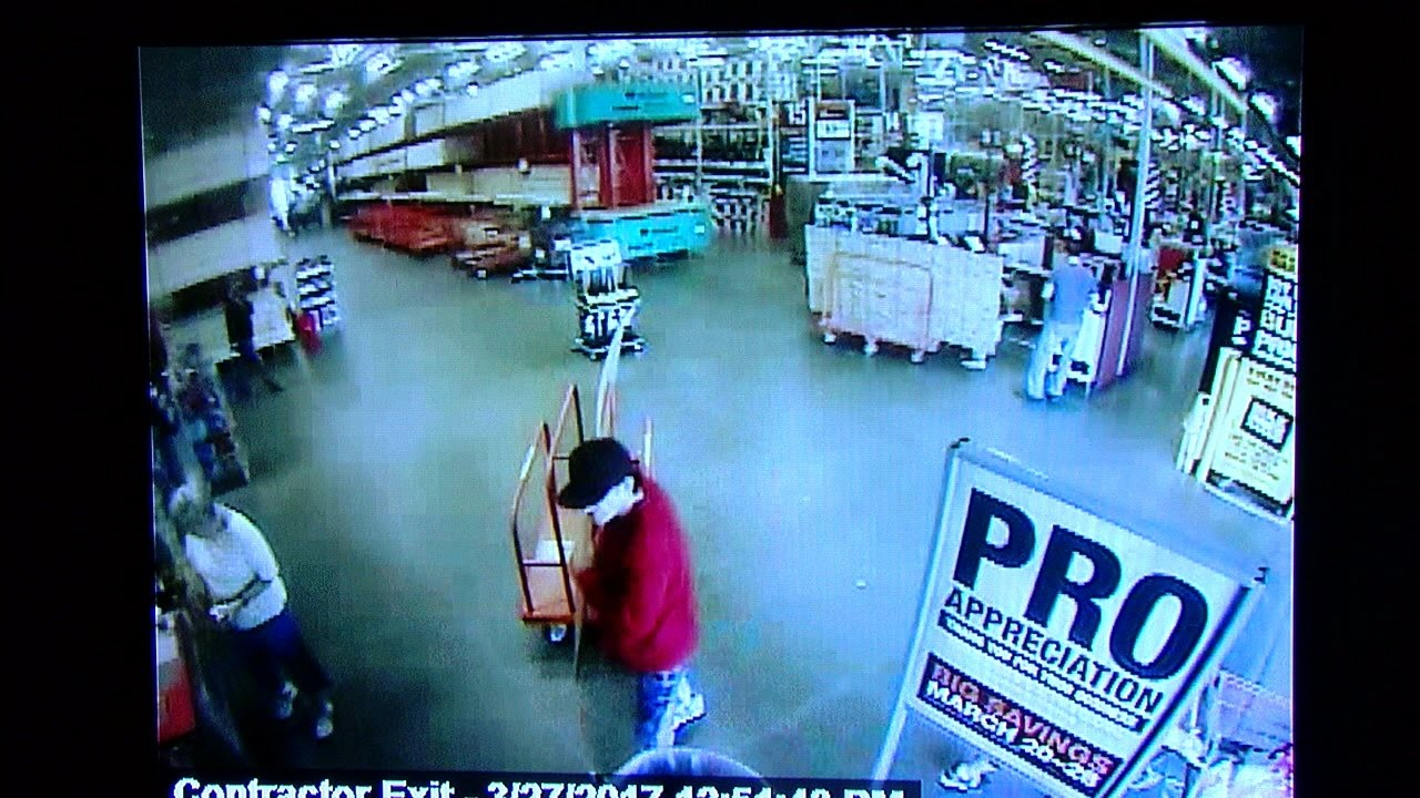 Video: Home Depot shoplifter drives off with worker on his car